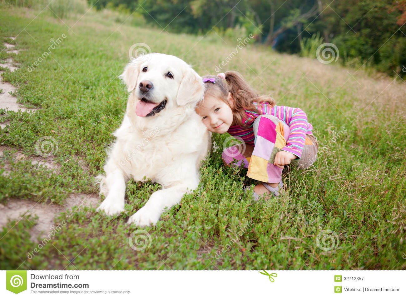 Free stock photography happy child and a dog breed golden retrieve