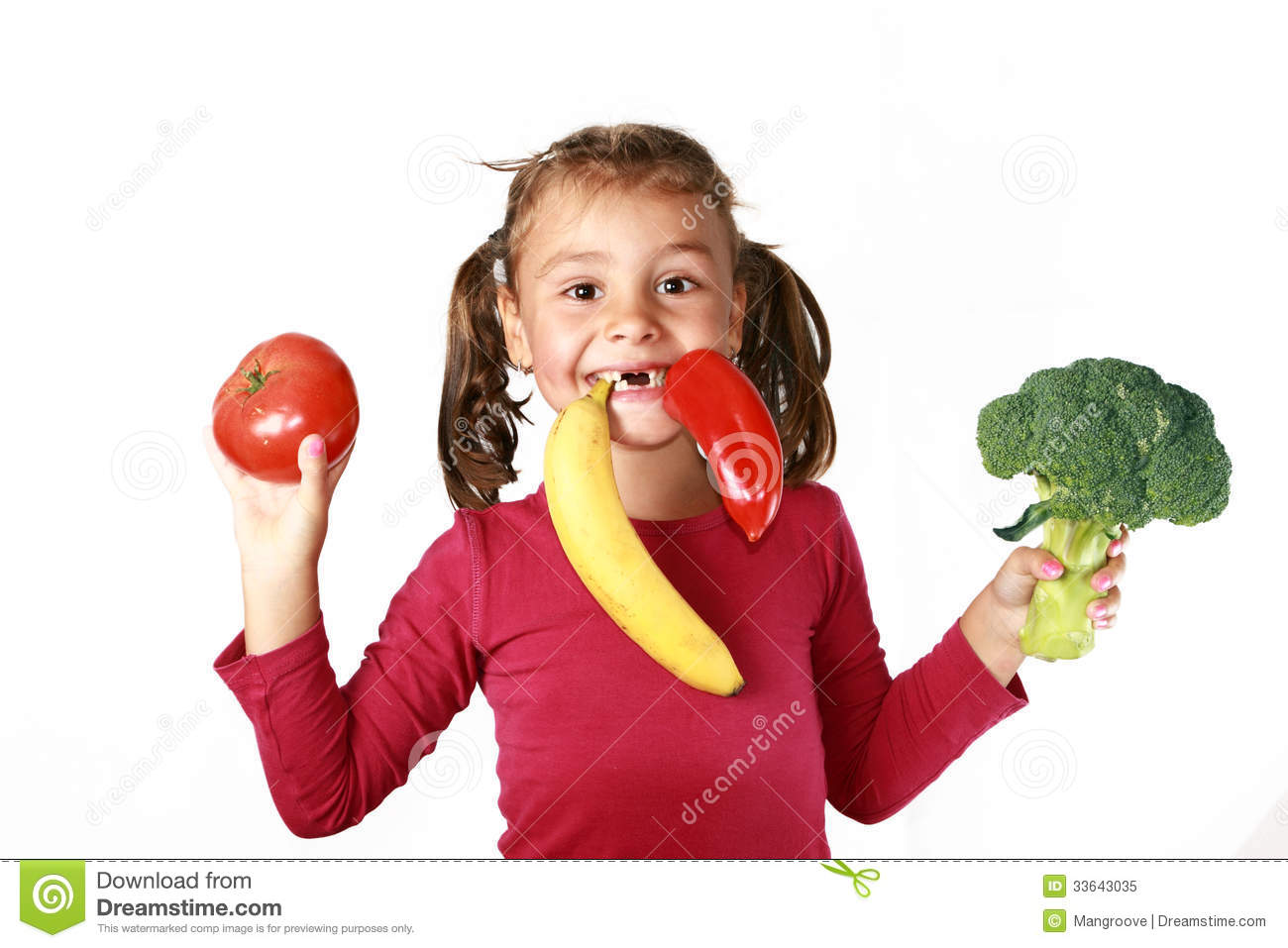 Happy child eating healthy food fruits vegetables