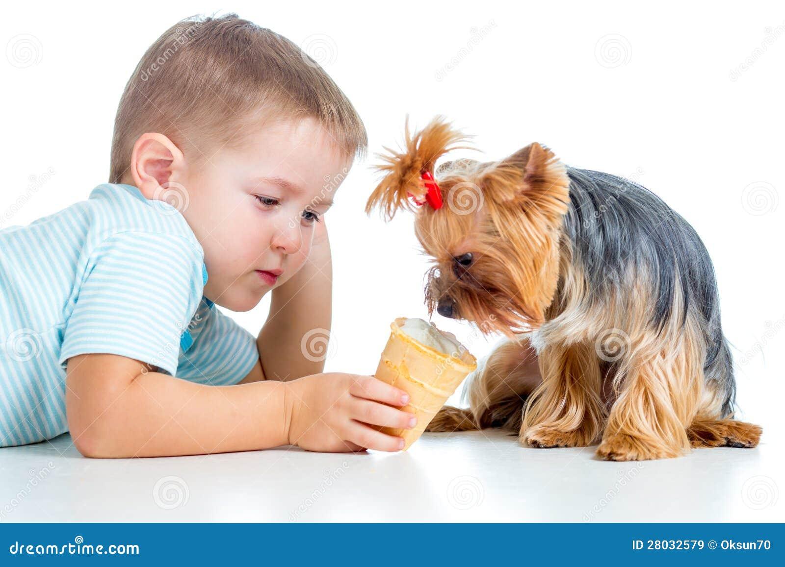 Happy child eating ice-cream isolated