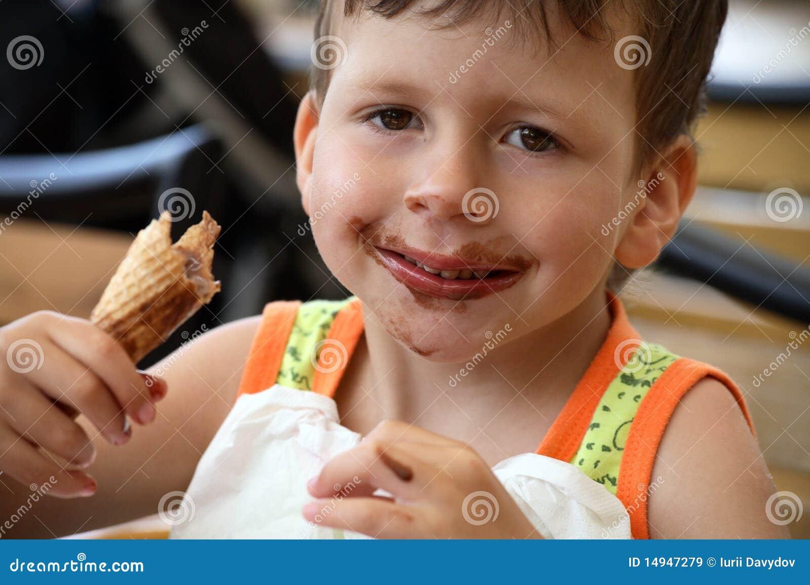 Happy child eats ice cream