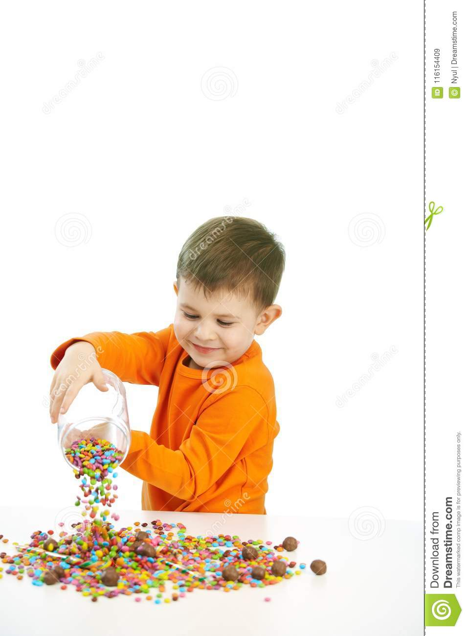 Little boy eating sweets
