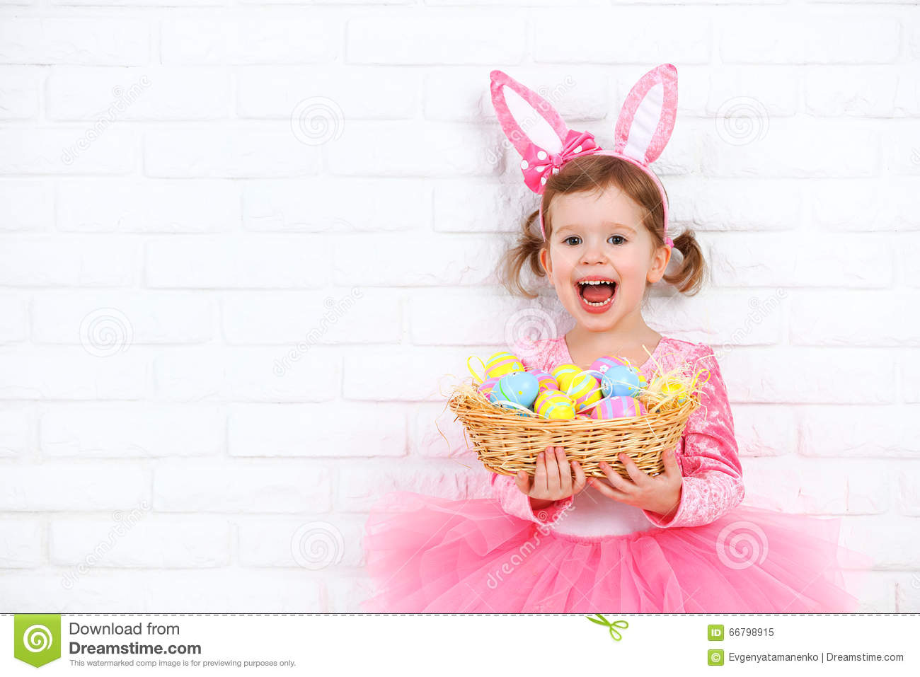 Happy Child Girl In A Costume Easter Bunny Rabbit With