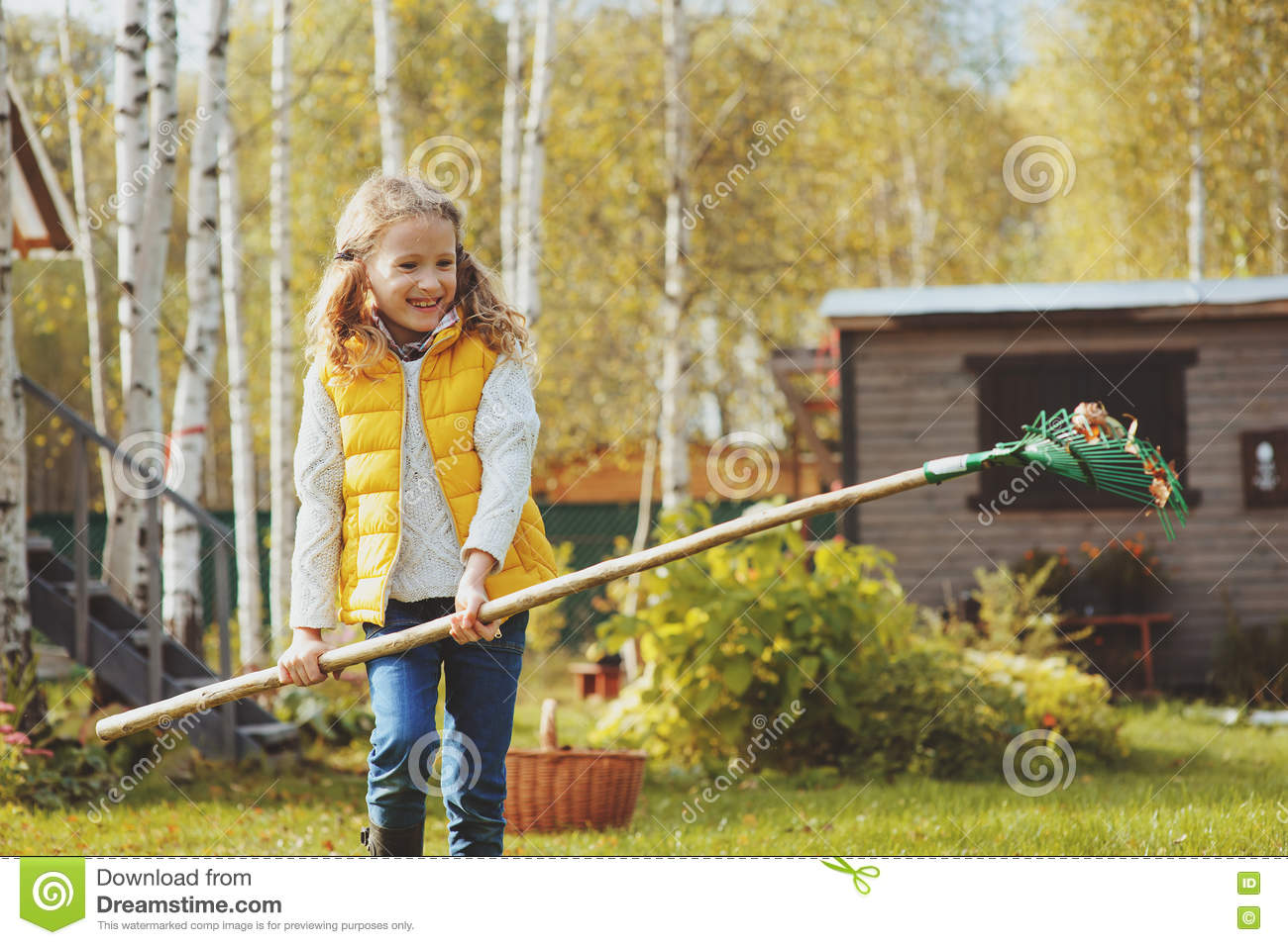 happy child playing little gardener in autumn and picking