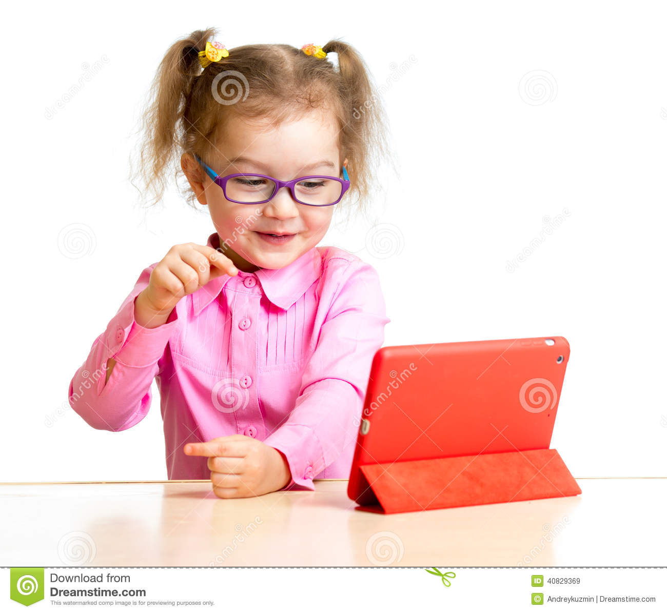 Happy child in glasses looking at ipad mini tablet pc screen