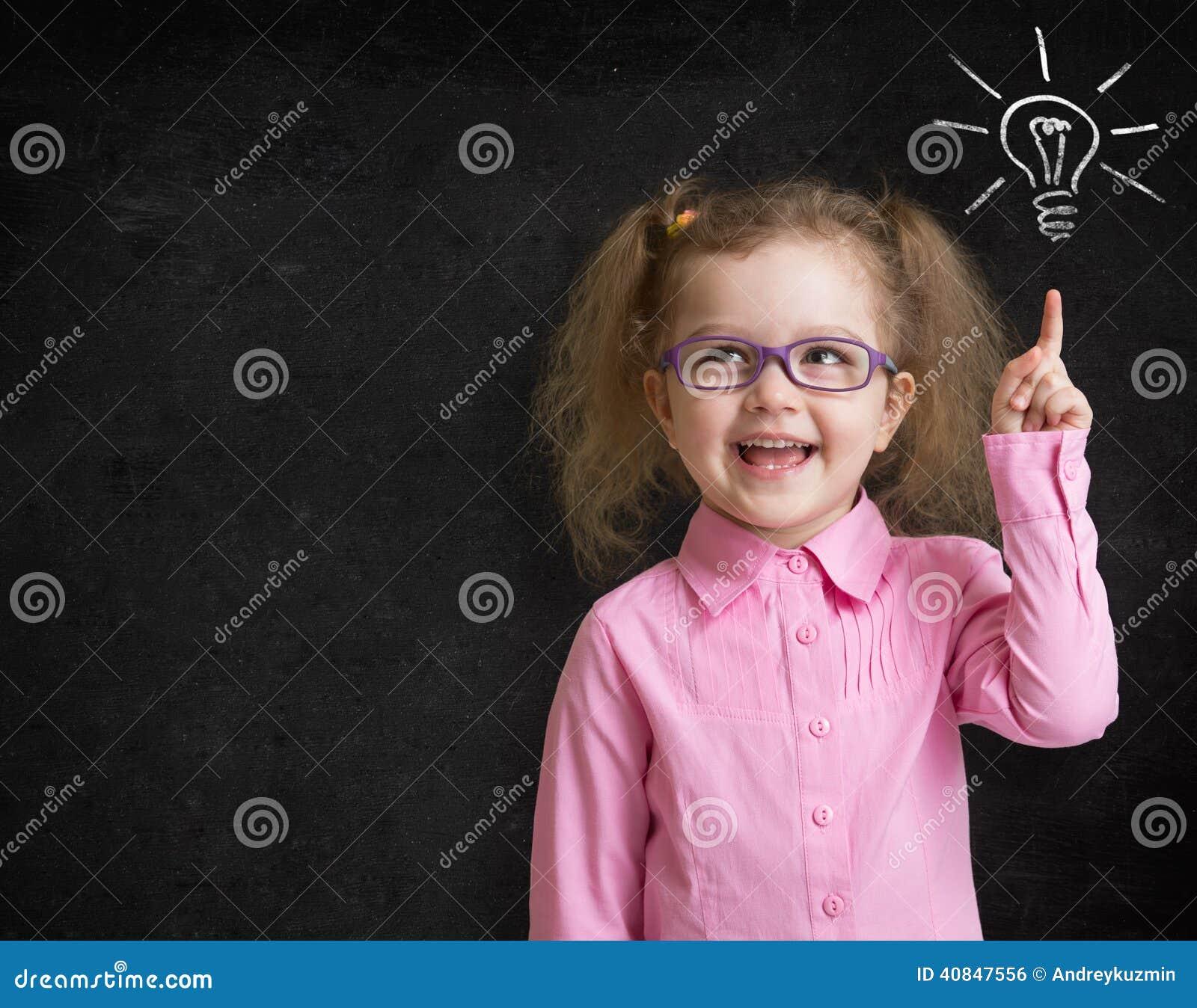 Happy Child In Glasses Standing Near School Chalkboard ...