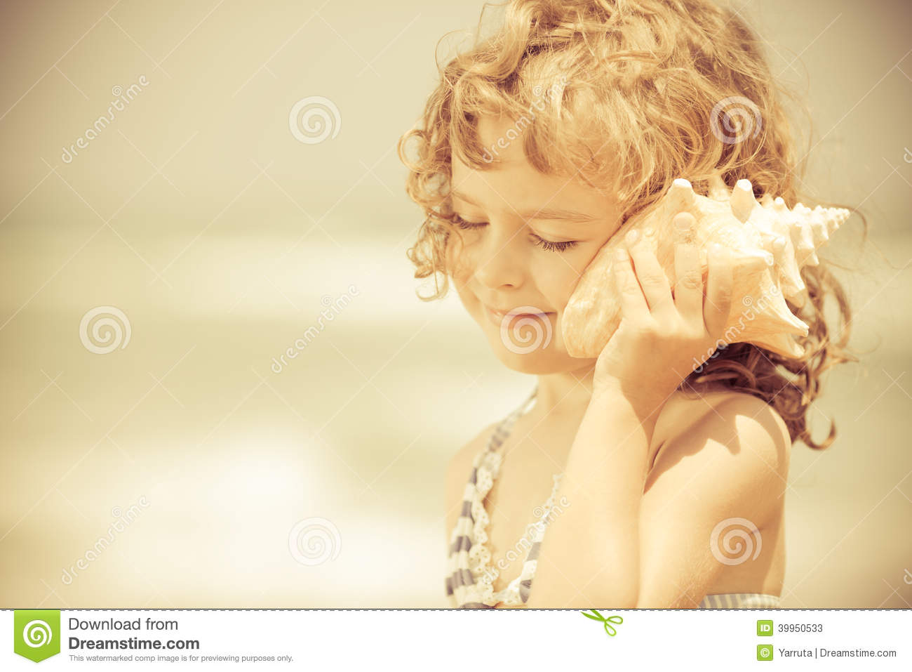 Happy Child Listen To Seashell At The Beach Stock Image