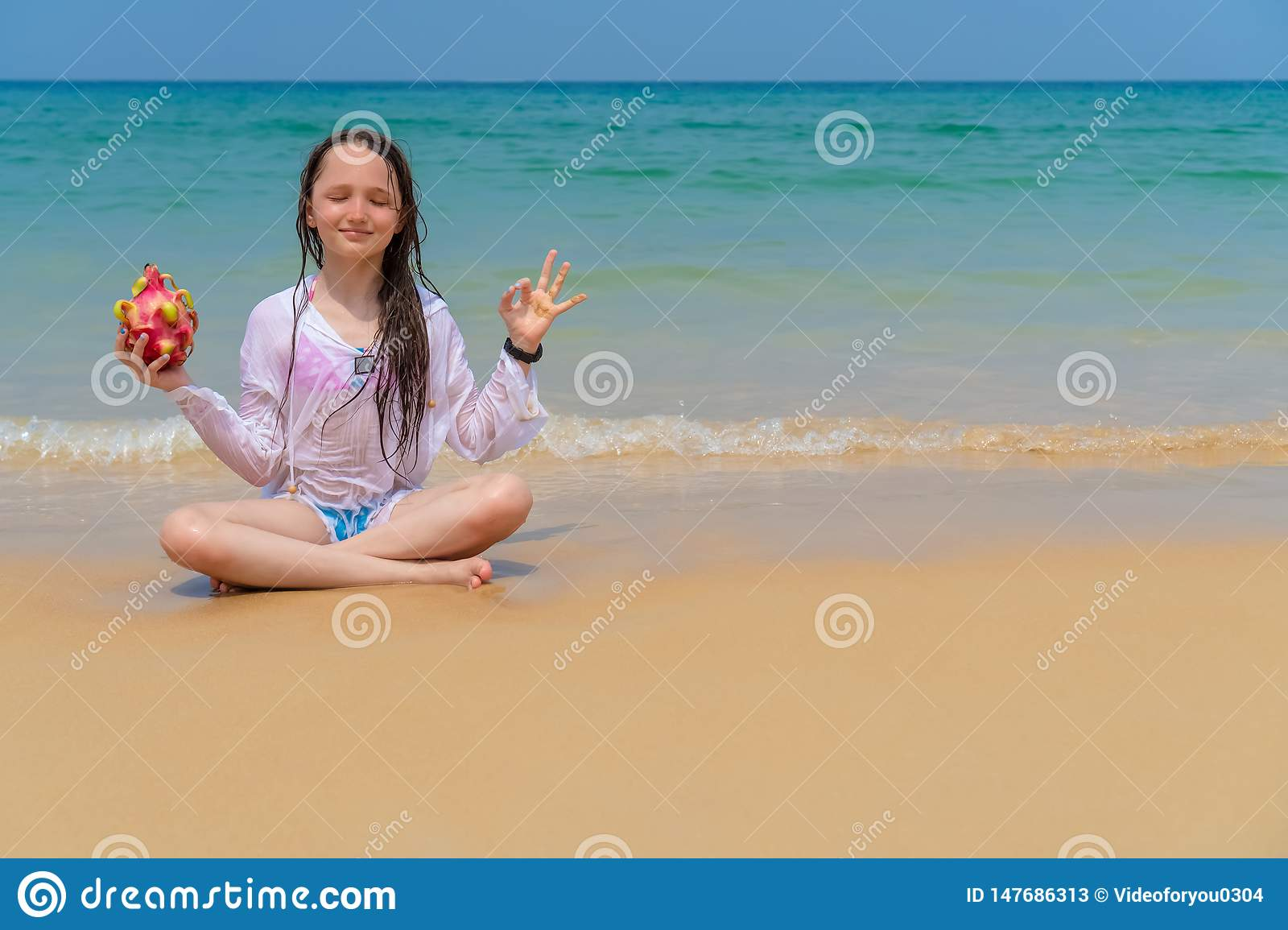 Happy child on the ocean with copy space