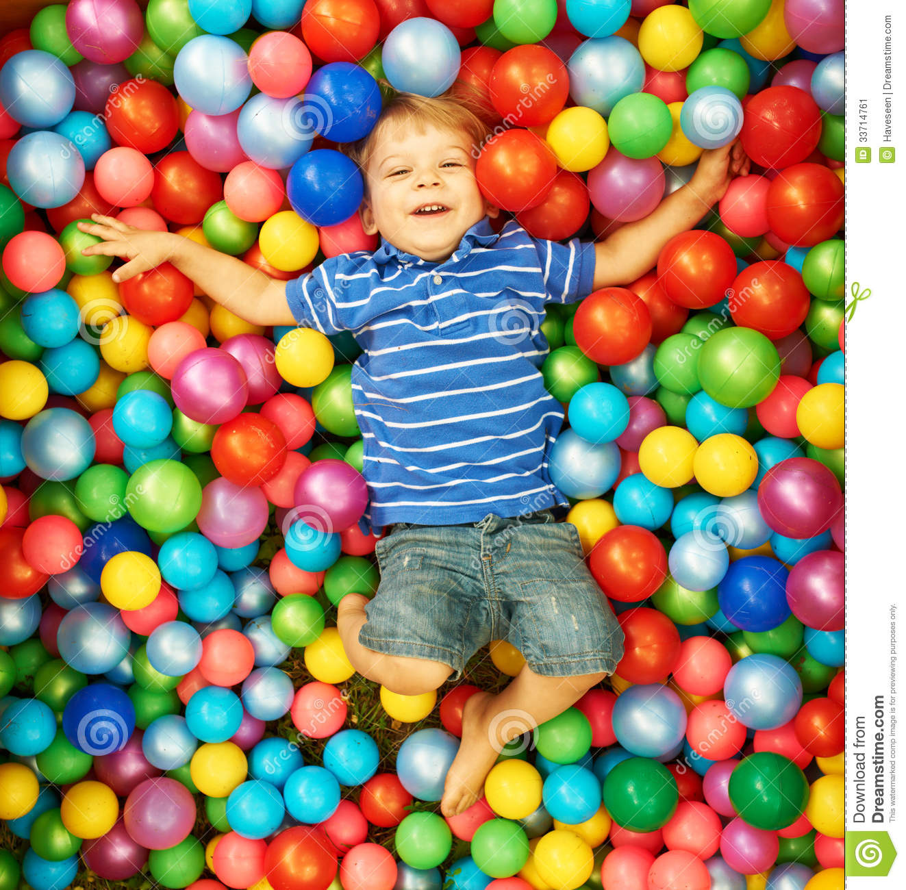 happy child playing with colorful plastic balls stock image image 33714761. Black Bedroom Furniture Sets. Home Design Ideas