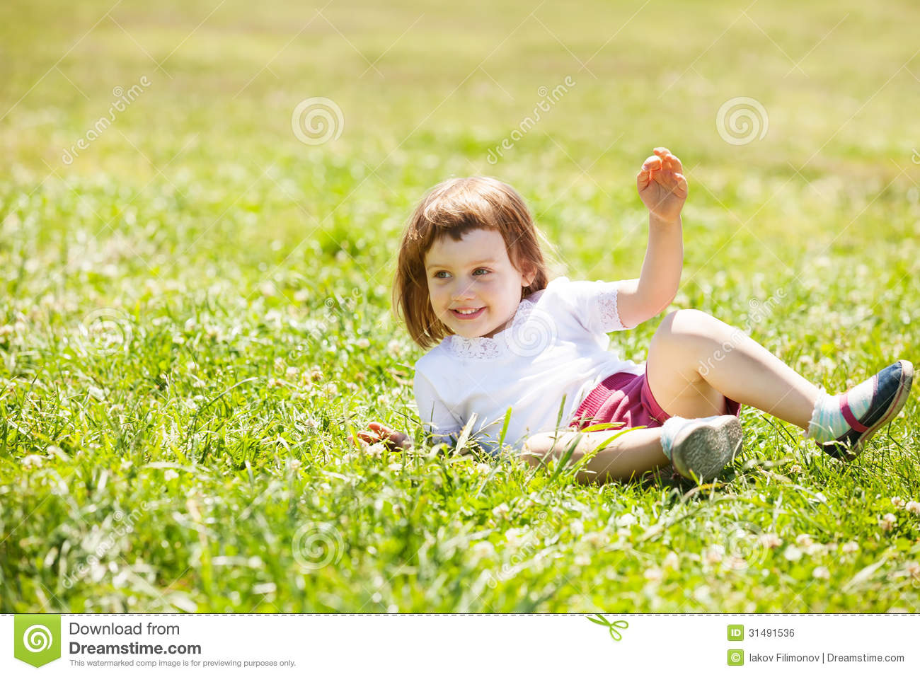 Happy Child Playing At Grass Meadow Royalty Free Stock