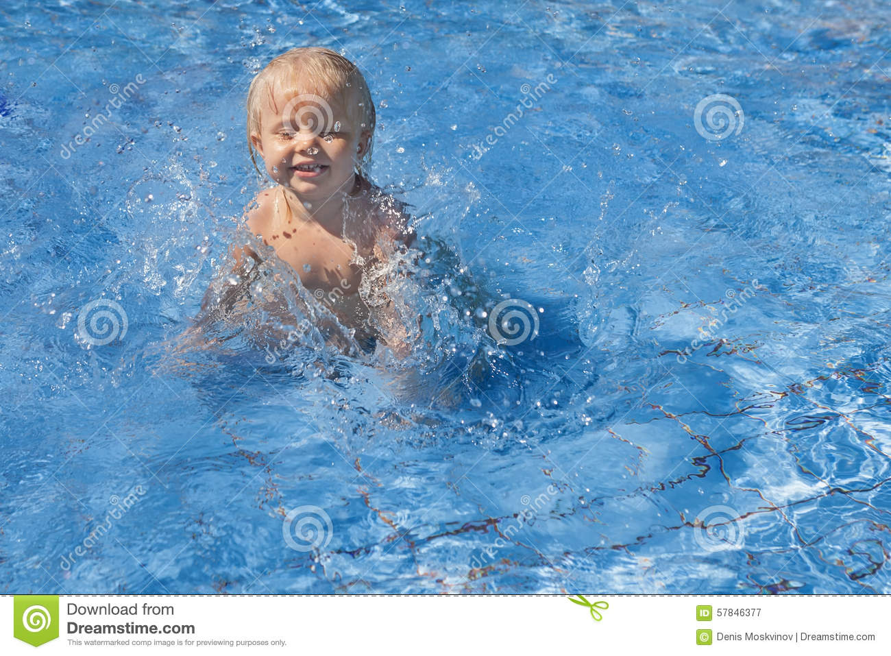 Happy Child Playing With Water Splashes In Pool Stock ...