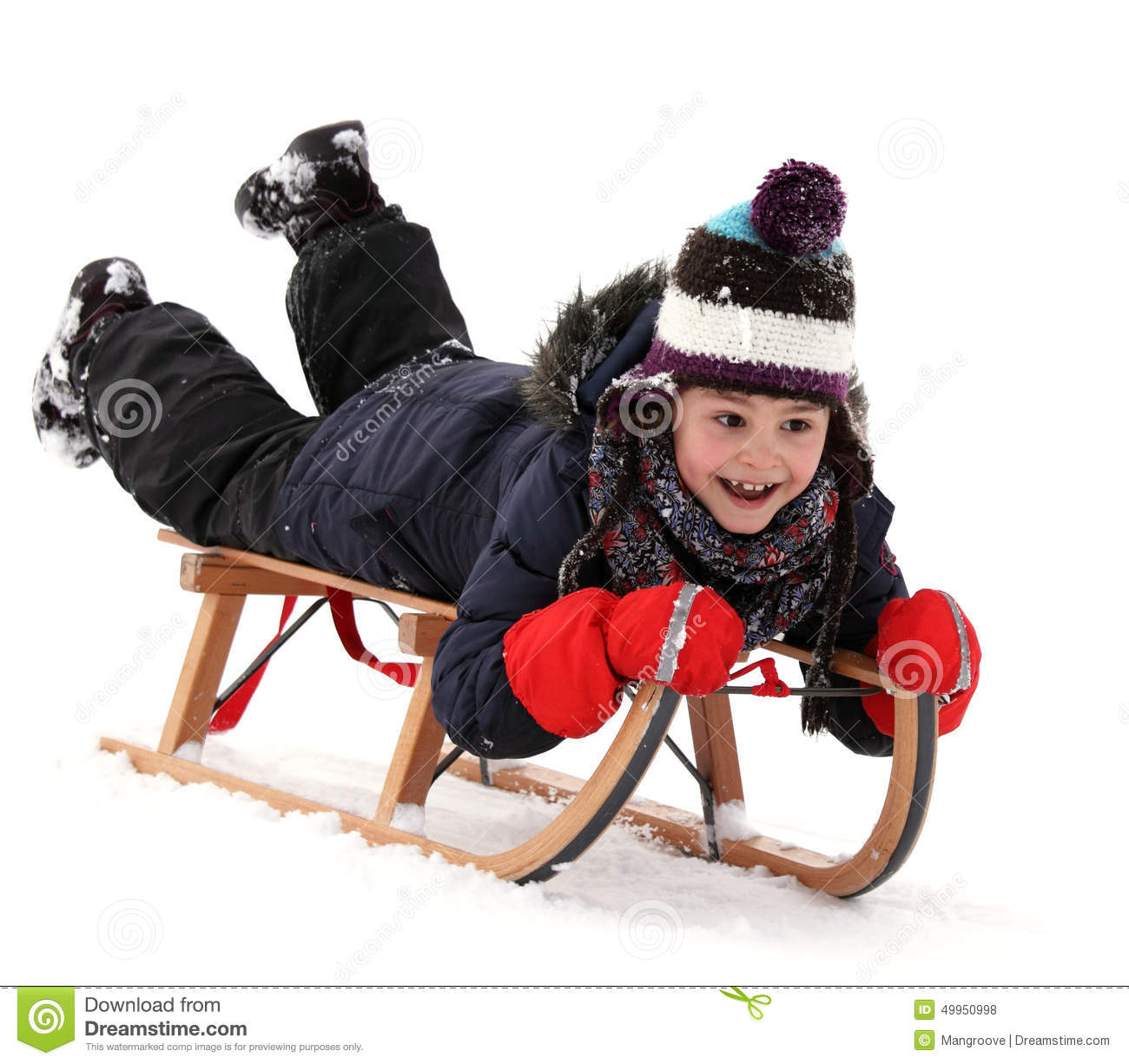 Happy child on sledge in winter