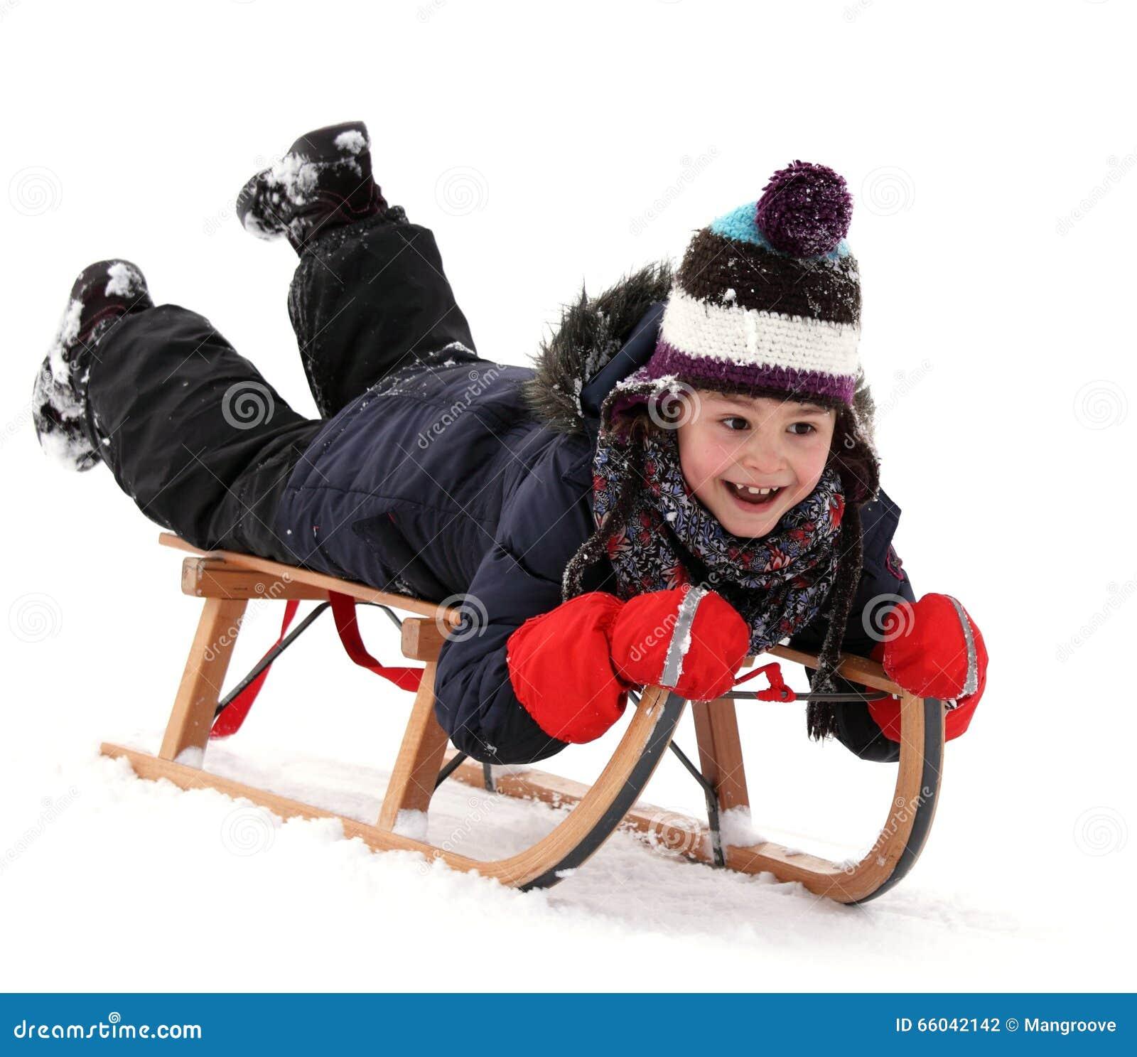 Happy child on sledge in winter, winter sports