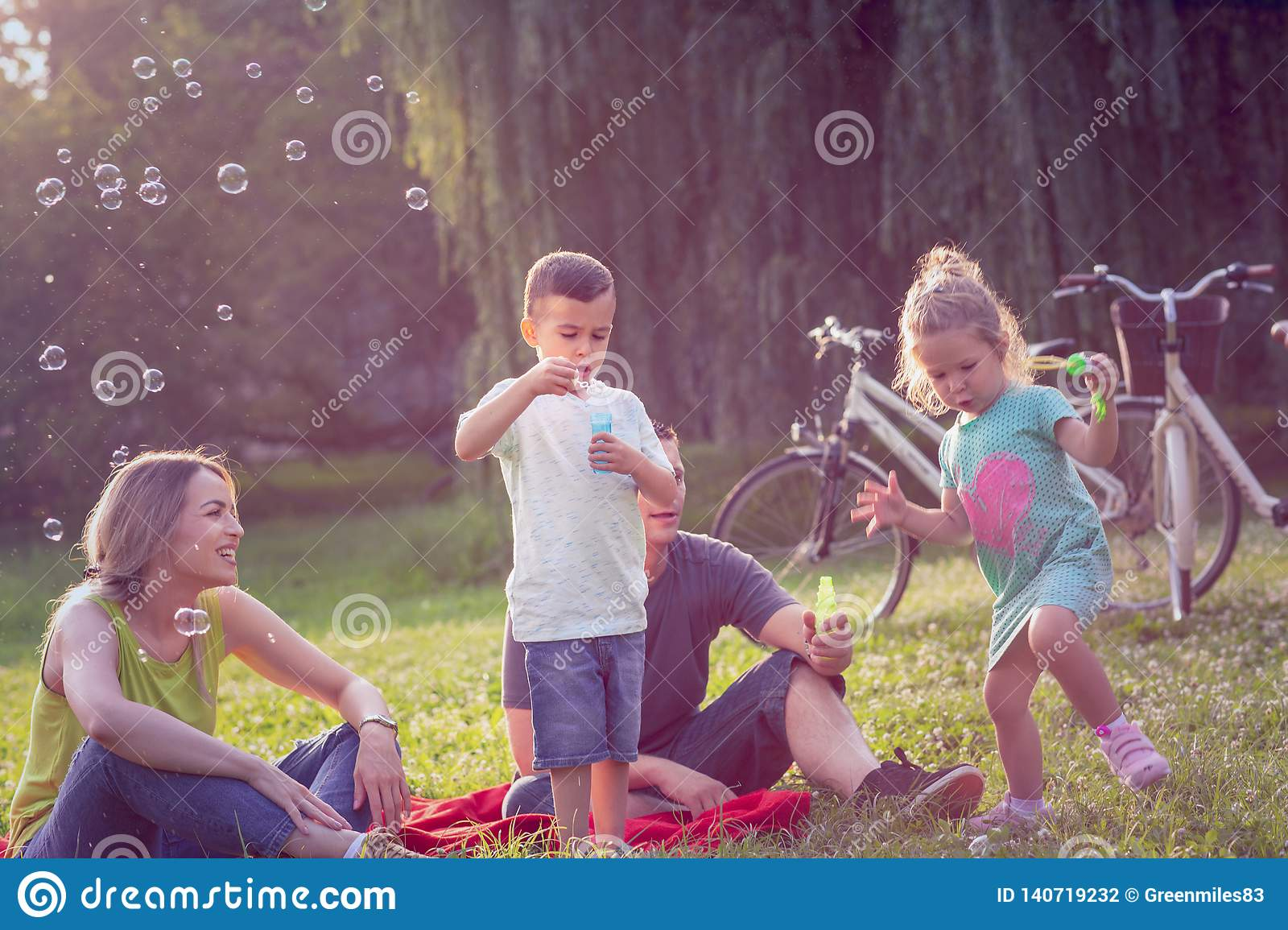 Happy Childhood-Happy Family With Children Blow Soap