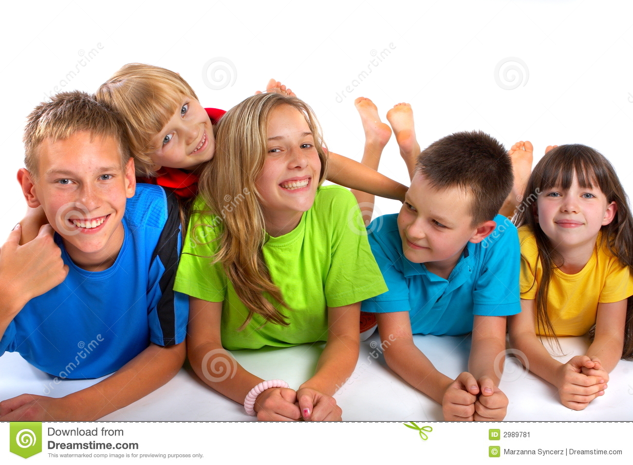 Portrait of five happy, smiling children, laying in a row on their ...
