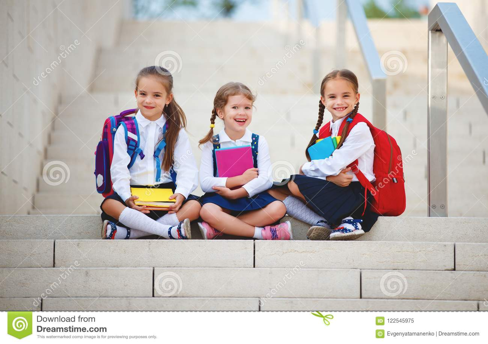 Happy children girlfriend schoolgirl student elementary school