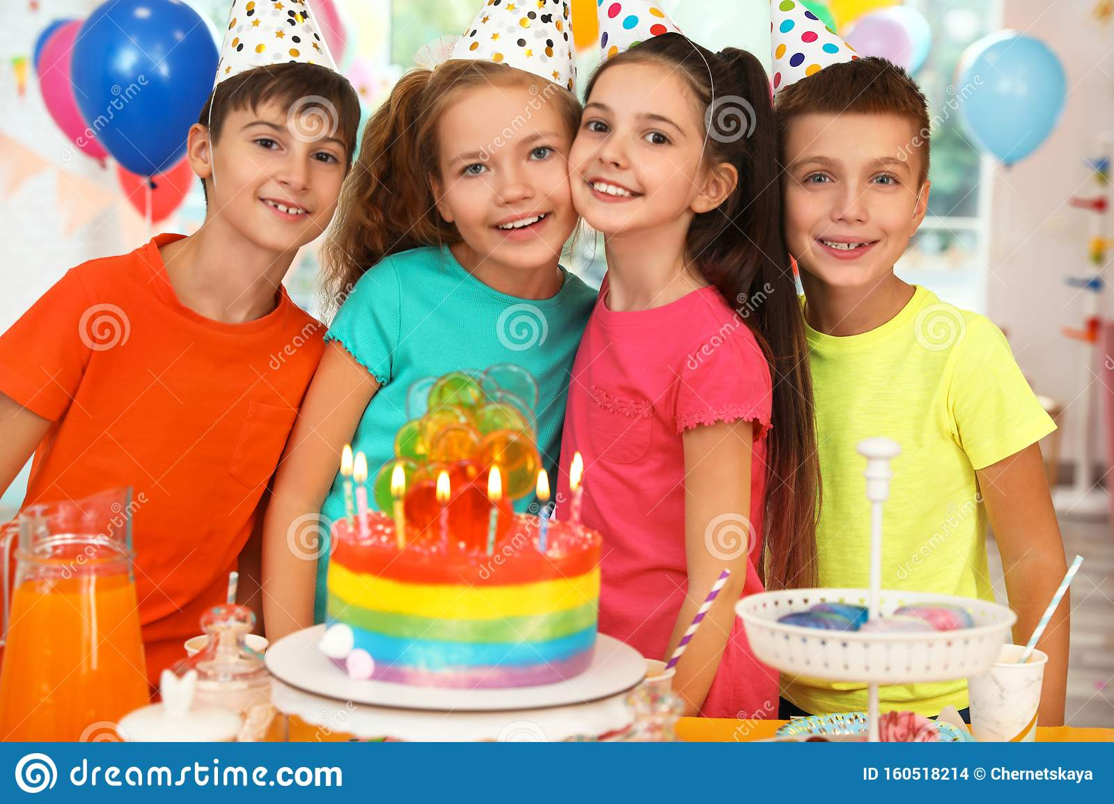 Happy Children Near Cake With Candles At Birthday Party ...