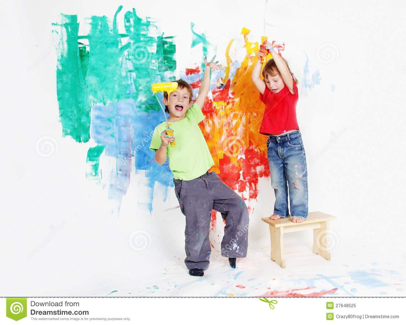 Happy children painting wall with colours royalty free for Children s mural artist