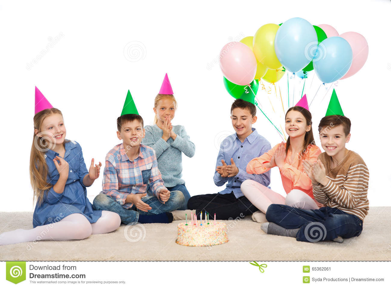 Happy Children In Party Hats With Birthday Cake Stock