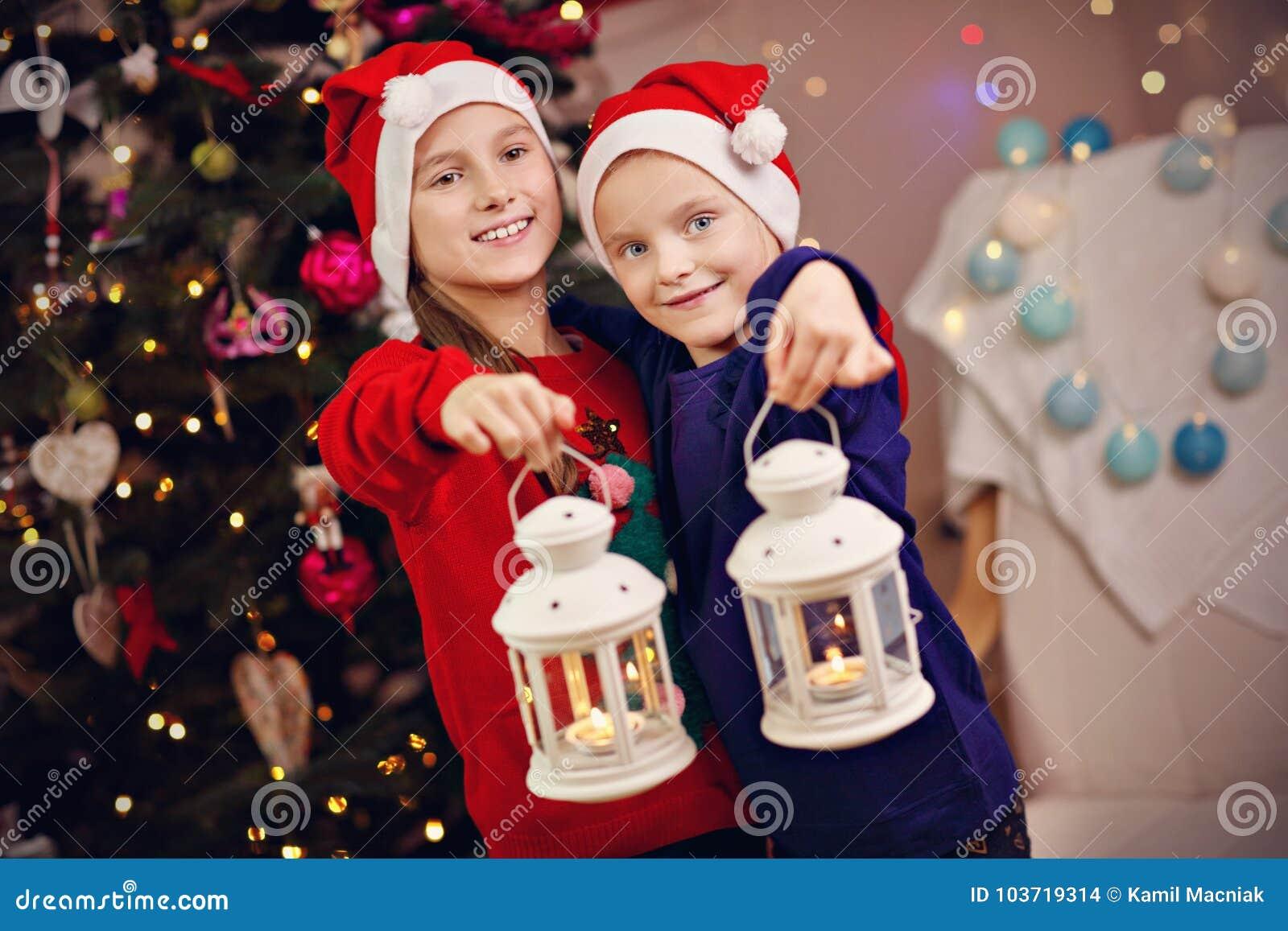 Christmas Lanterns.Happy Children Posing With Christmas Lanterns Stock Photo