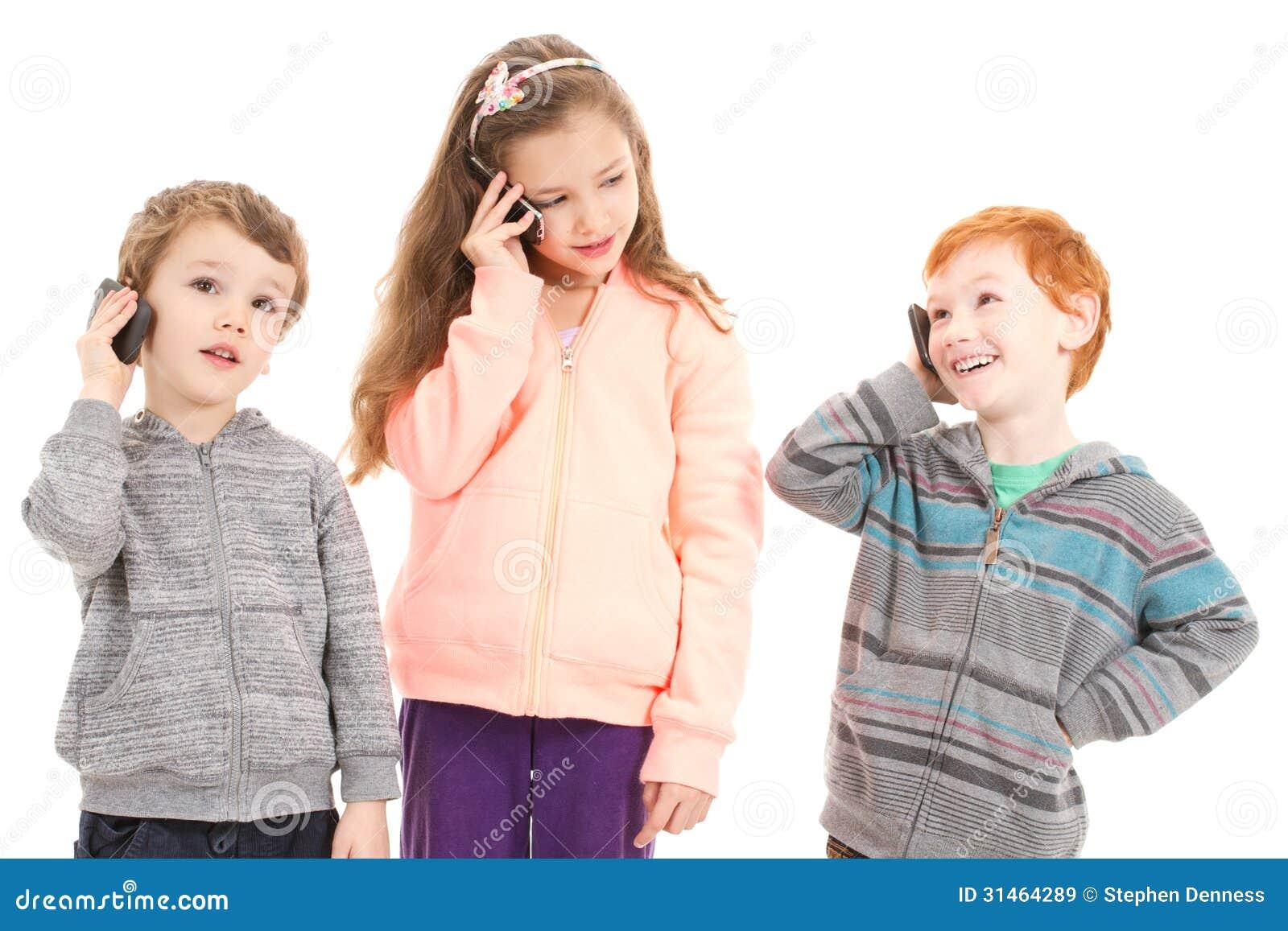 Happy Children Talking On Mobile Phones Stock Image ...