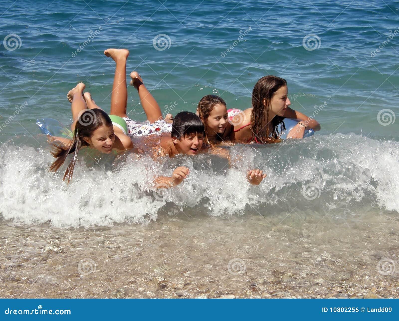 Happy childrens enjoy on waves