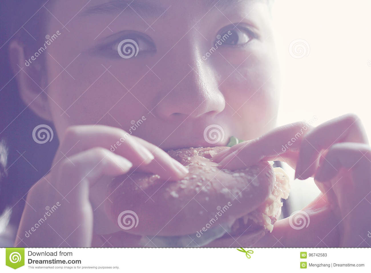 Happy Chinese beauty girl eat hamburger closeup, blank white background
