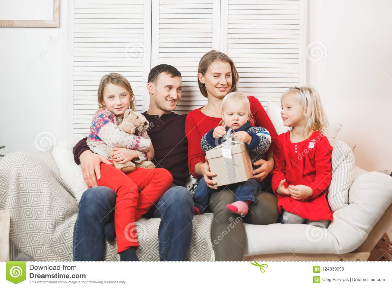 Happy Christmas Family with Kids opening Gift