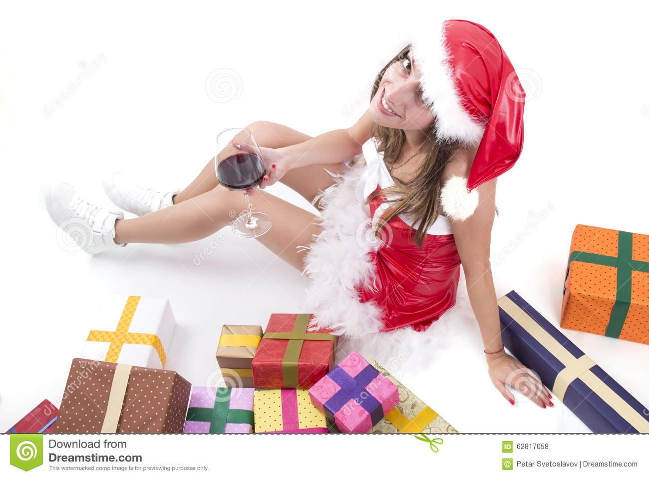 Happy Christmas Girl With Glass Of Red Wine And Gifts Stock Photo ...