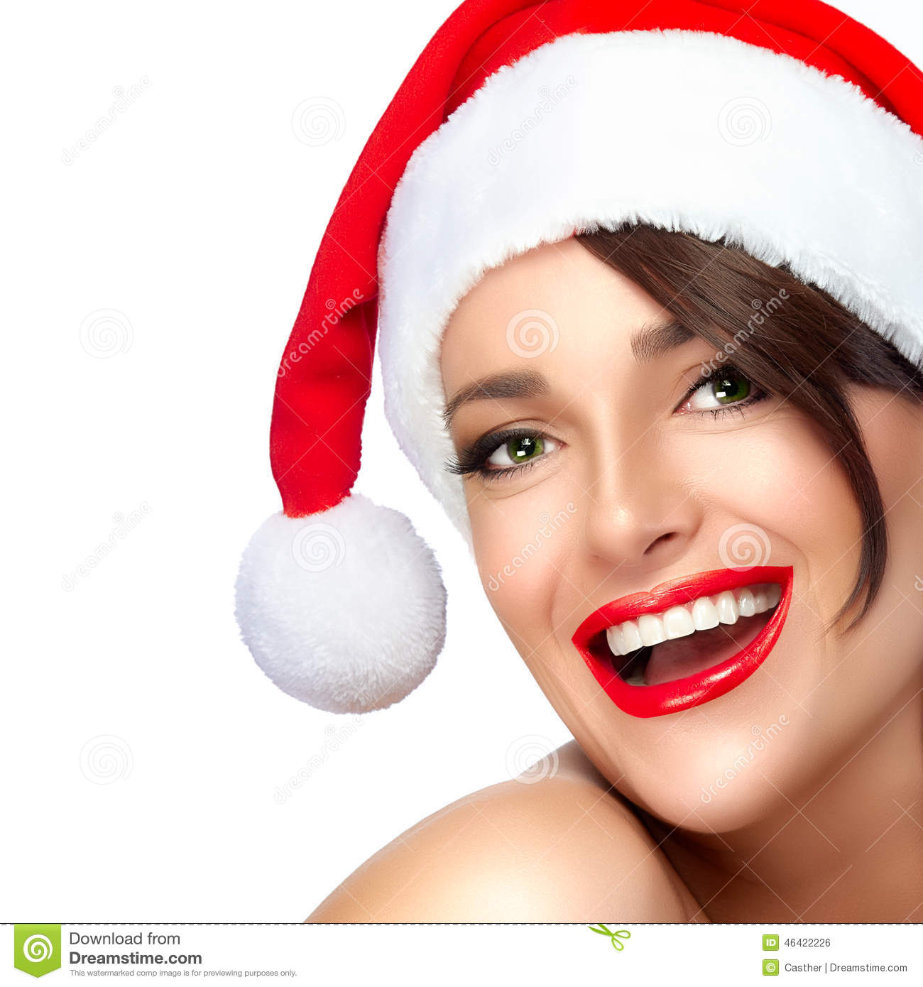 Happy Christmas Girl In Santa Hat. Beautiful Big Smile