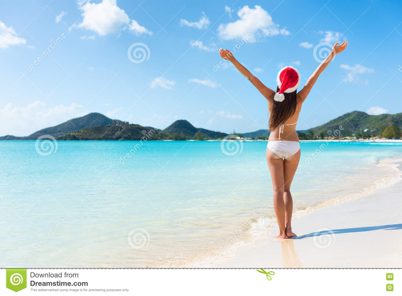 Happy Christmas holiday woman on beach vacation