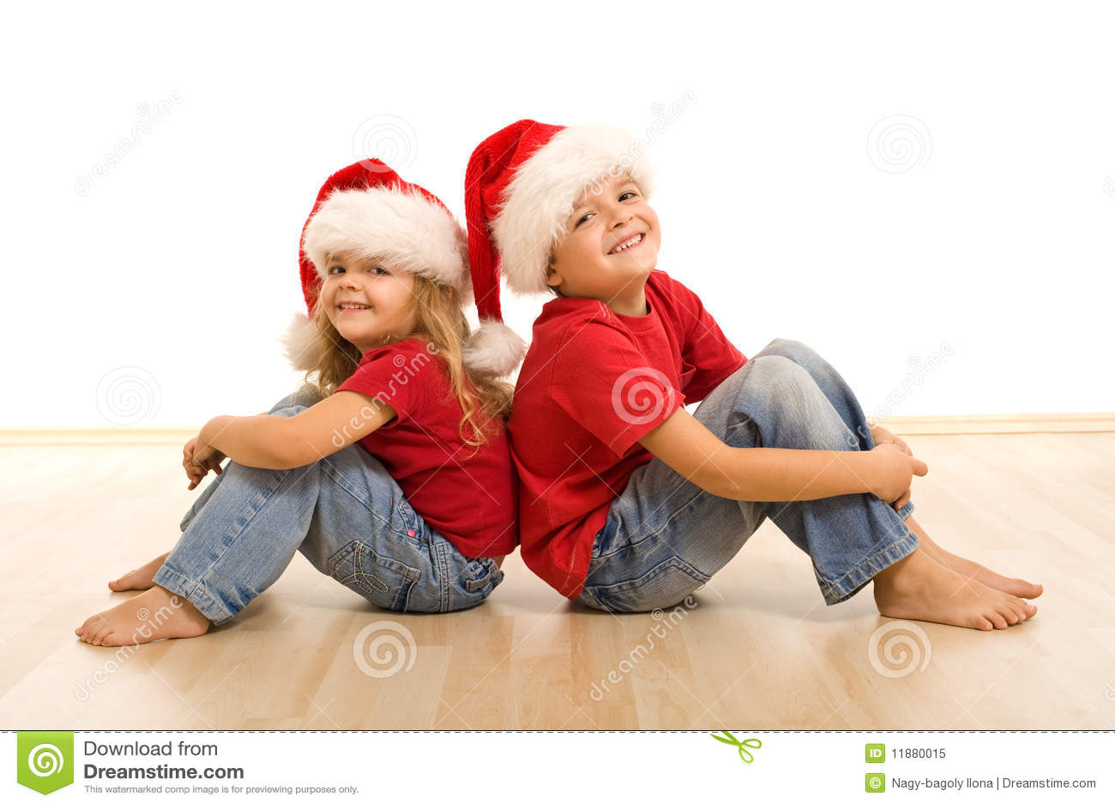 Happy christmas kids sitting on the floor stock image for On the floor on the floor