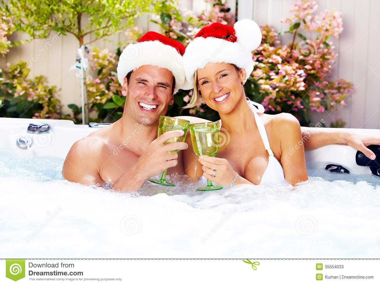 Happy christmas santa couple in jacuzzi stock photos for Health spa vacations for couples