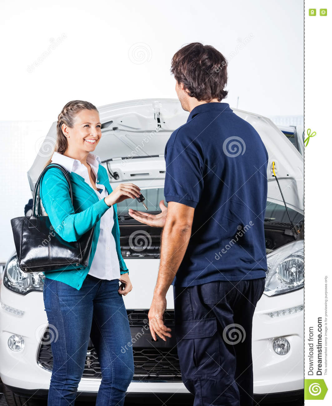 happy client giving car keys to mechanic stock photo image 70689602. Black Bedroom Furniture Sets. Home Design Ideas