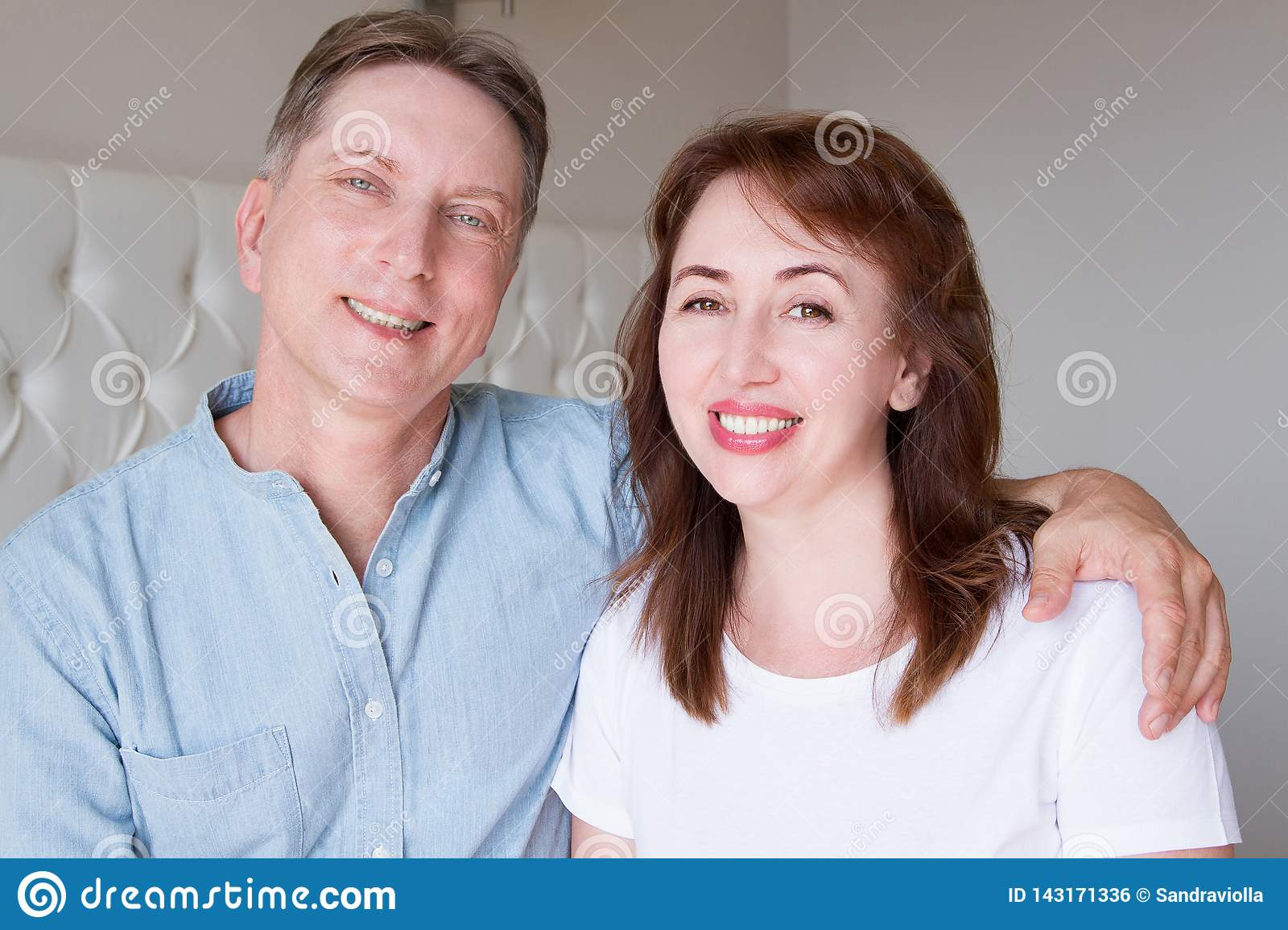 Happy closeup people faces. Smiling middle age couple at home. Family fun time weekend and strong love relationship. Healthy smile