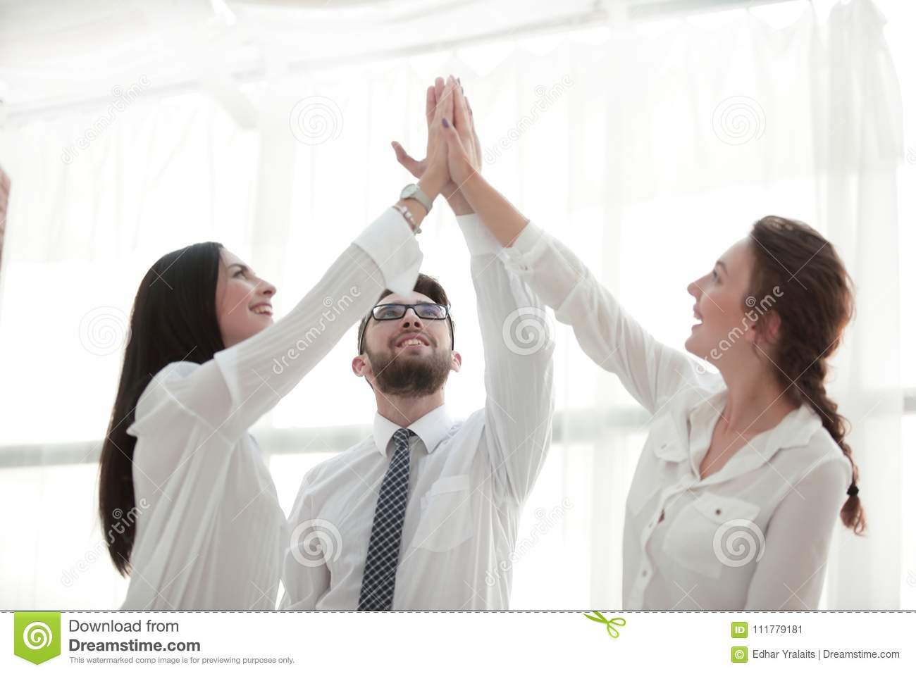 Happy colleagues giving each other a high five
