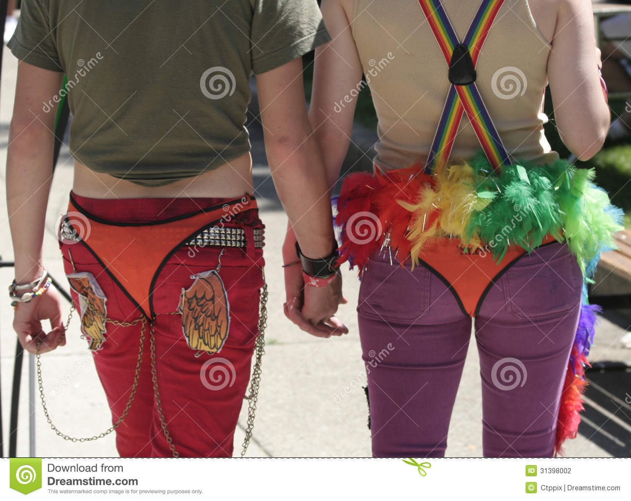 A Happy and Colorful Couple holding hands at Indy Pride