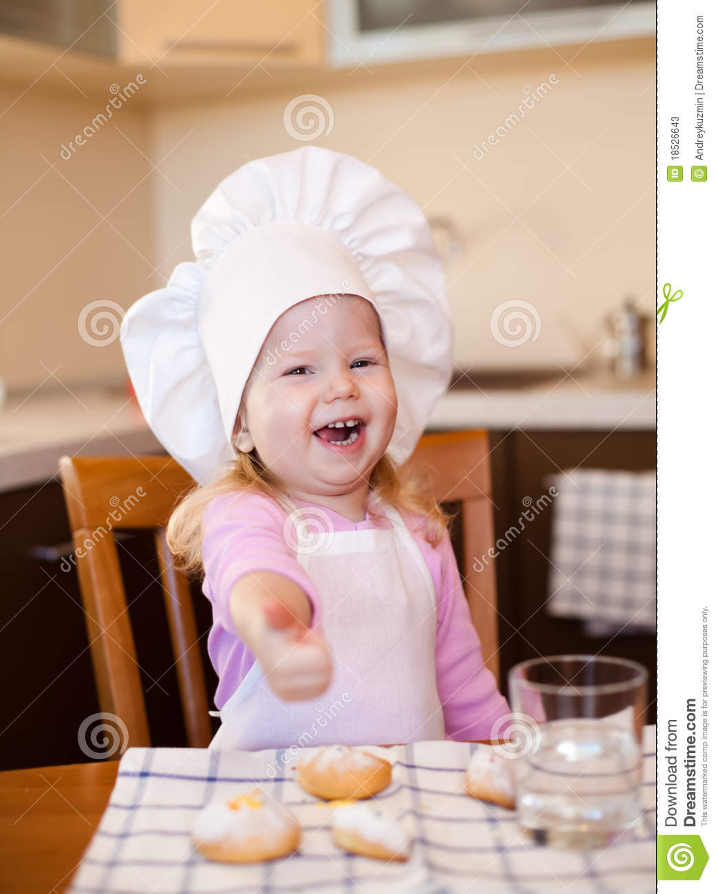 Happy Cook Girl Sitting At Kitchen With Cookies Stock