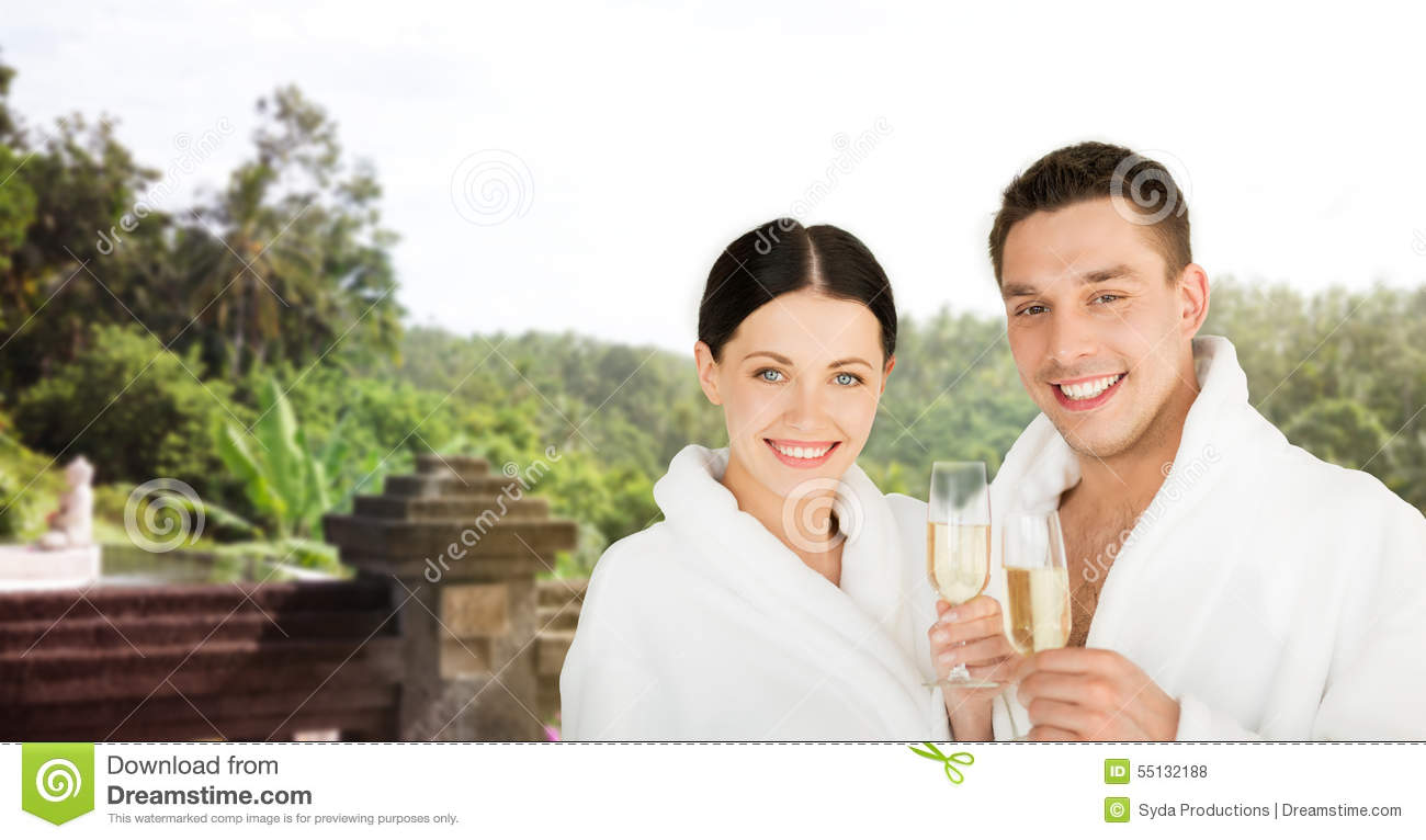 Happy couple in bathrobes over spa hotel resort stock for Spa vacations for couples