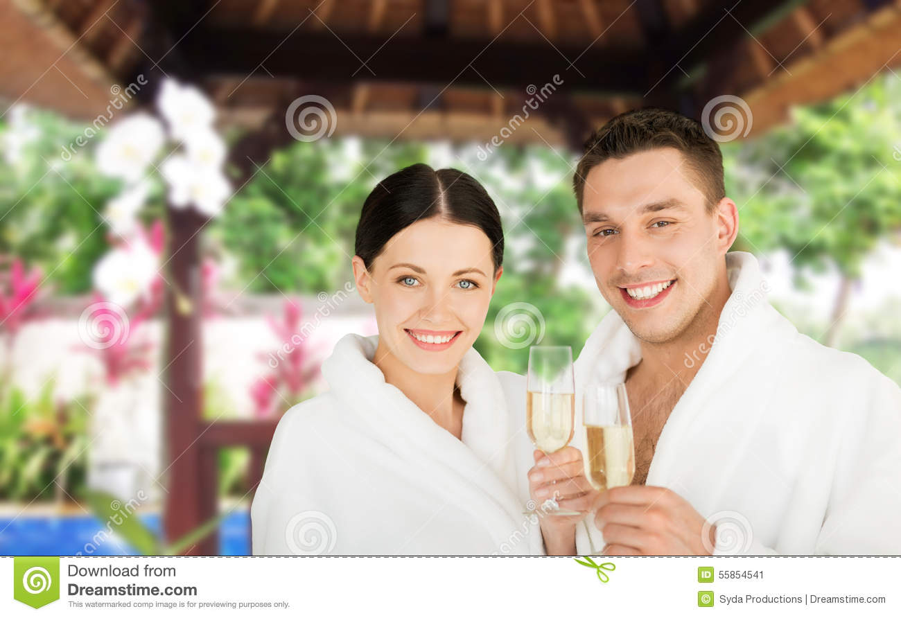couple in bathrobes hugging by palm trees stock photo. Black Bedroom Furniture Sets. Home Design Ideas