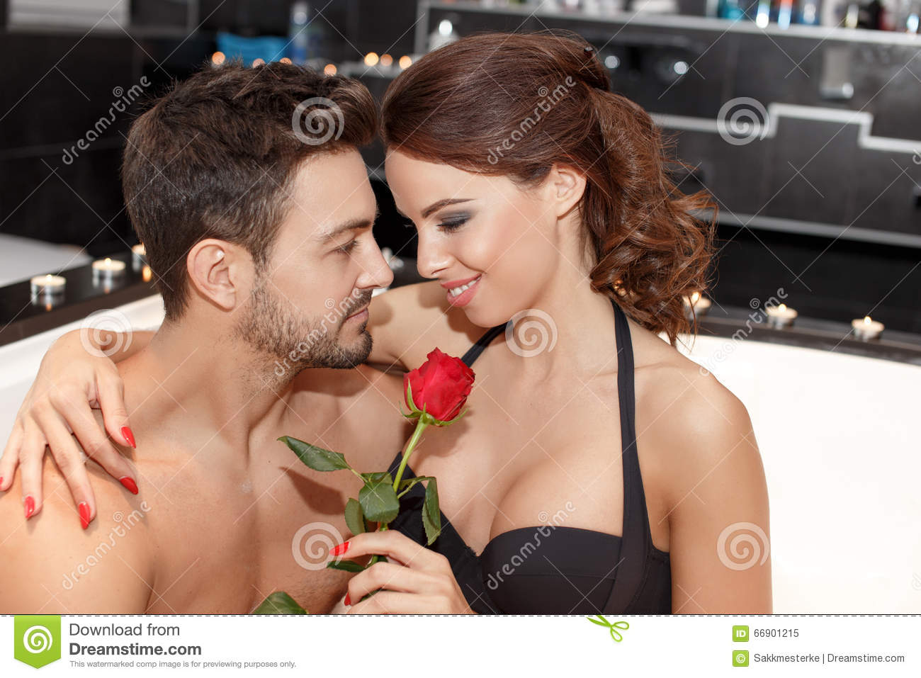 Download Happy Couple In Bathroom With Rose Stock Image