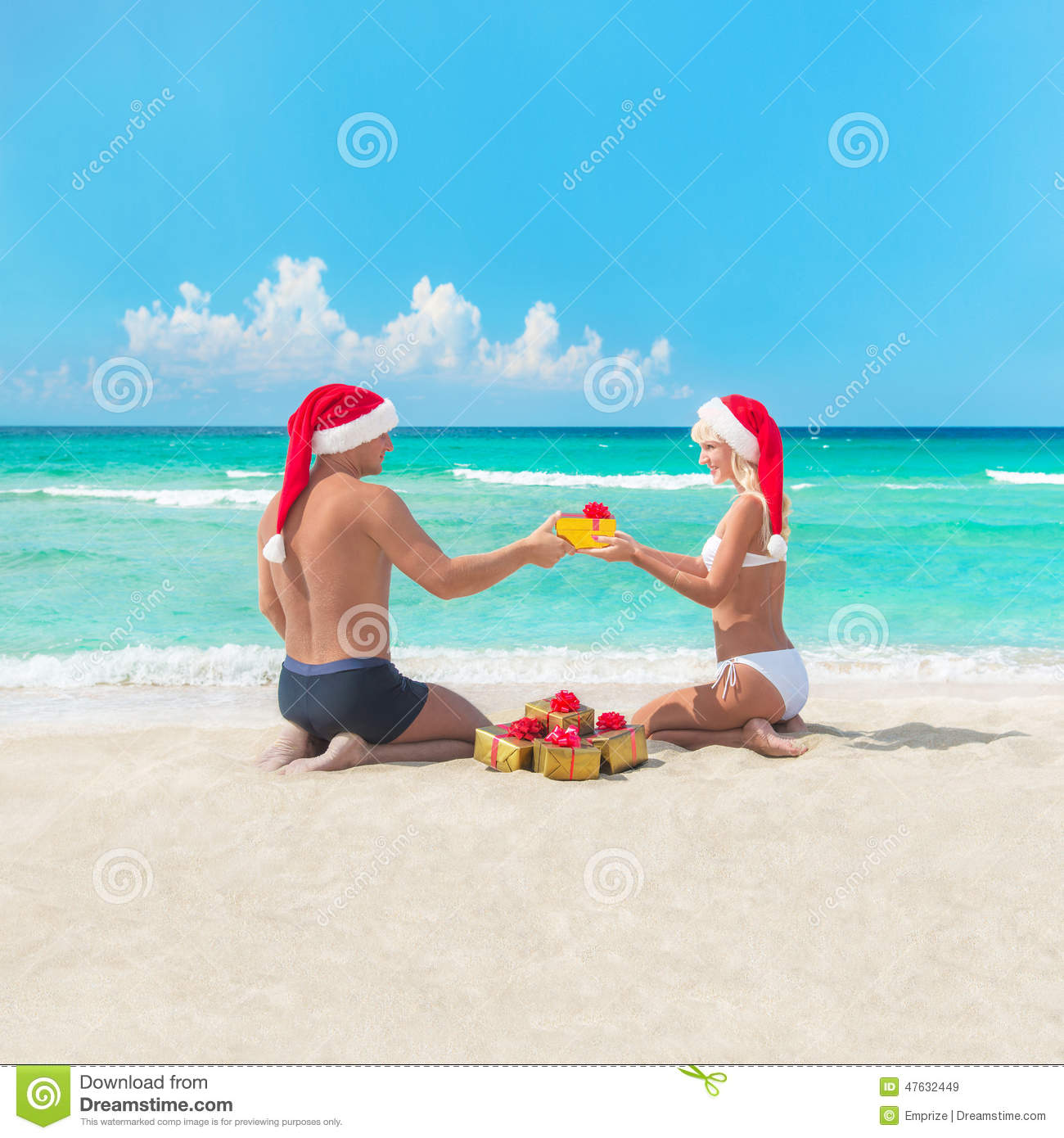 Couple At The Beach Stock Image Image Of Caucasian: Happy Couple At Beach In Santa Hats Making Presents For