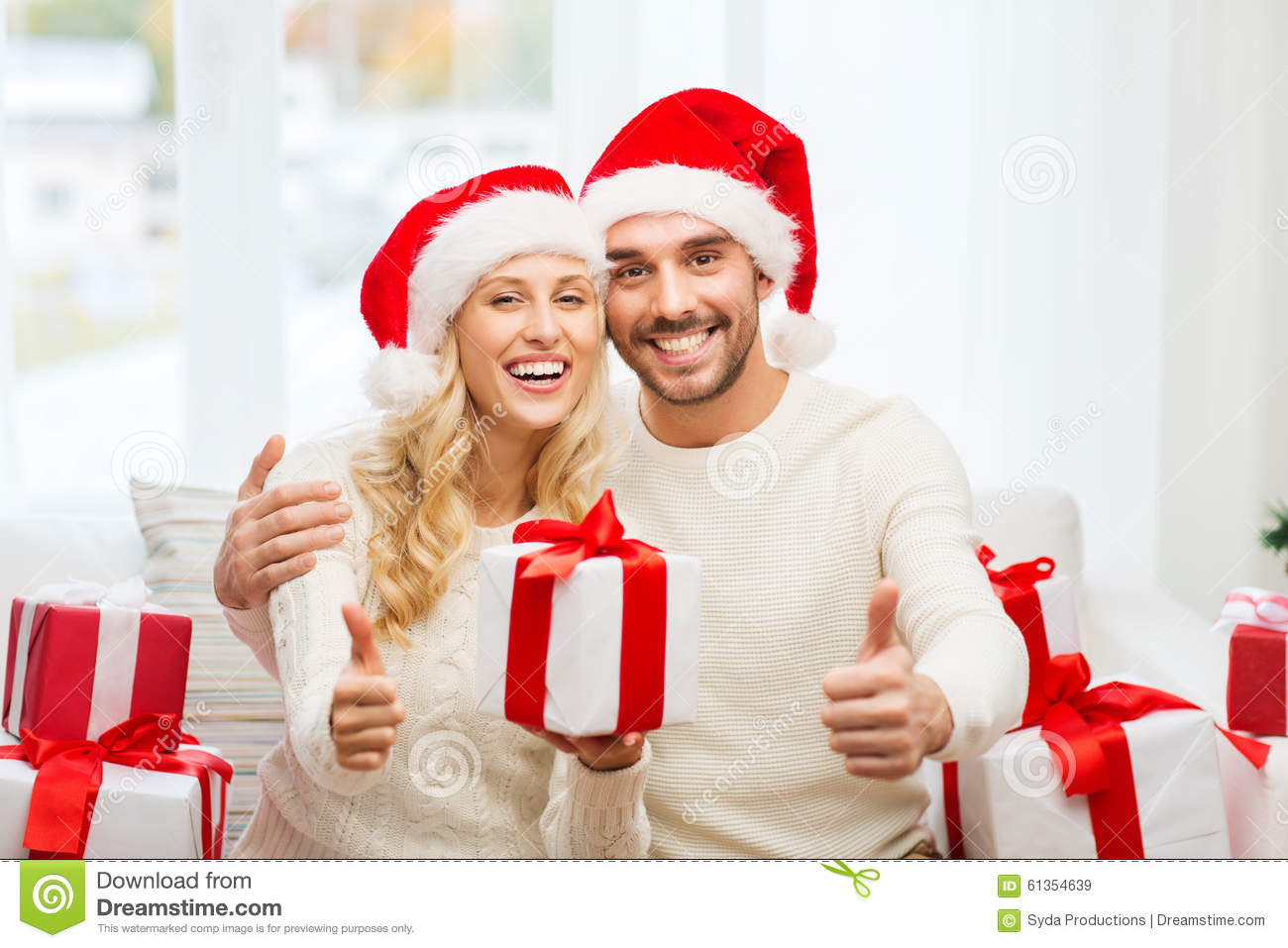 Happy Couple With Christmas Gifts And Thumbs Up Stock Image - Image ...