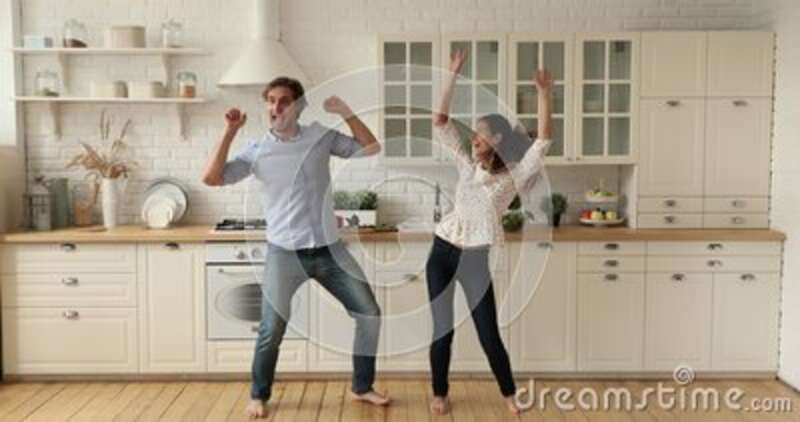 Happy Couple Dancing In Domestic Kitchen While Listen Energetic Music Stock Video Video Of Energetic Affection 197955113