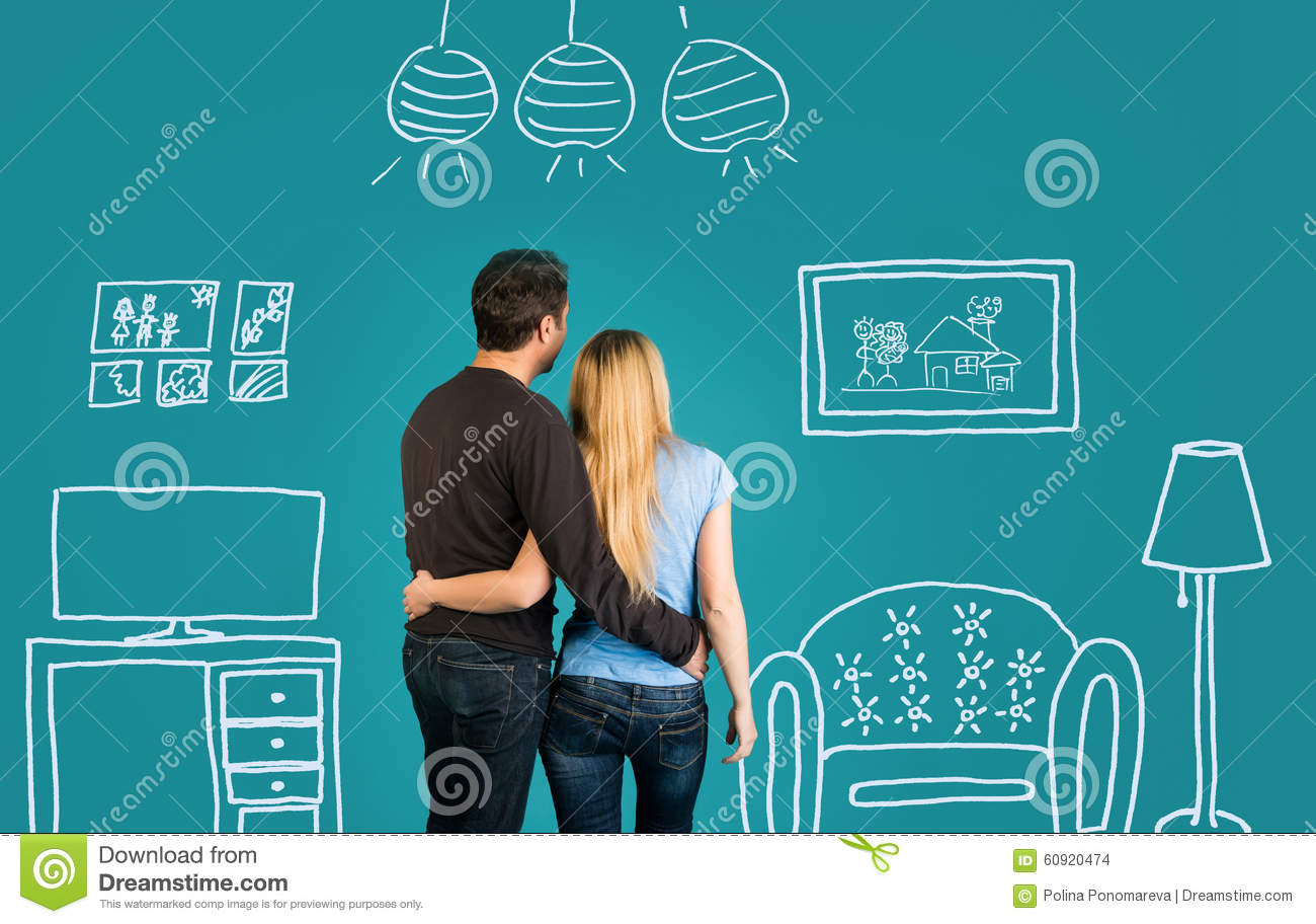 Happy Couple Dreaming Of Their New Home Or Furnishing On Blue Background. Family With Sketch Drawing Of Their Future Flat Interior
