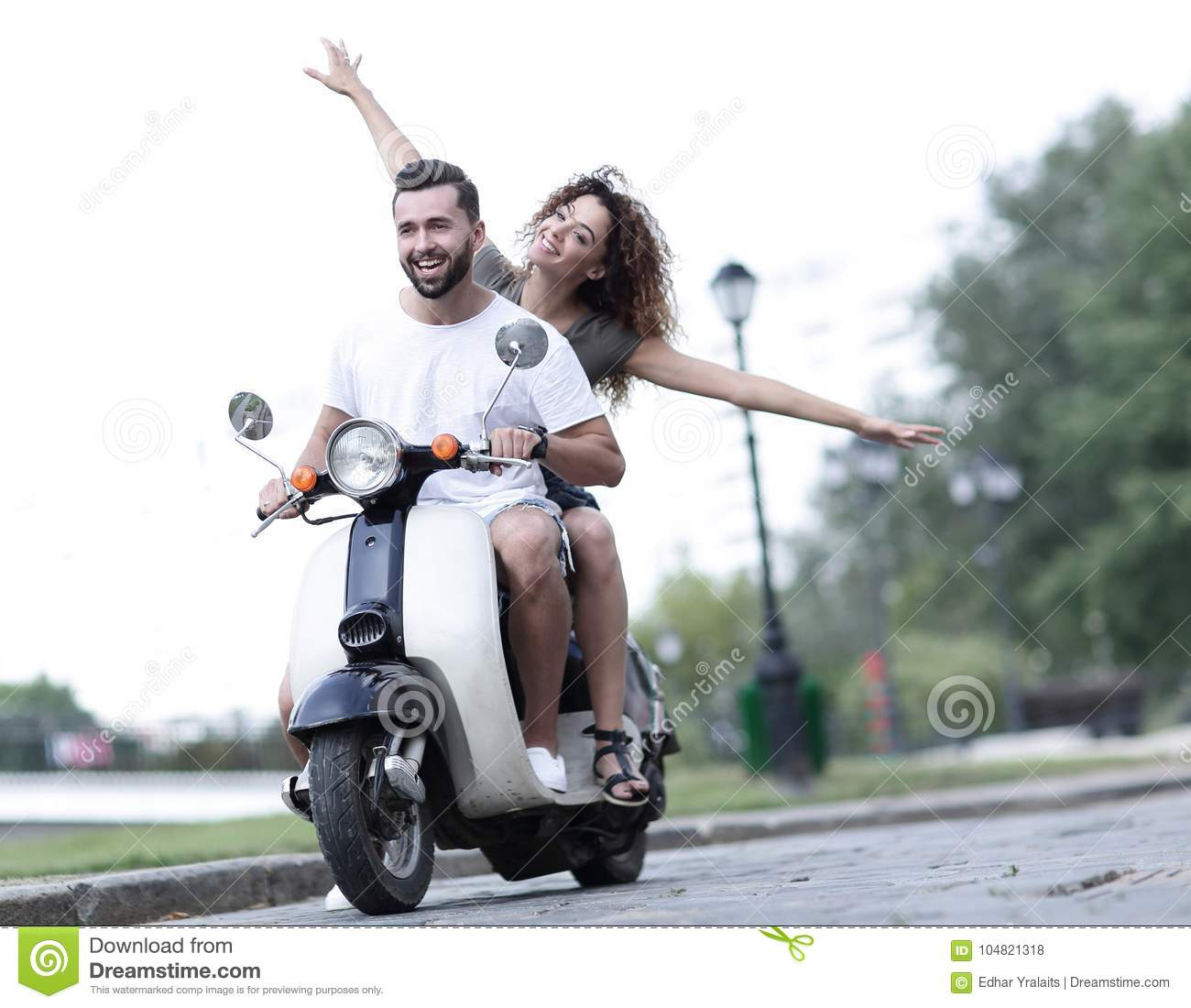 Couple Enjoying Their Summer Holidays Stock Photo: Happy Couple Driving Scooter Excited On Summer Holidays