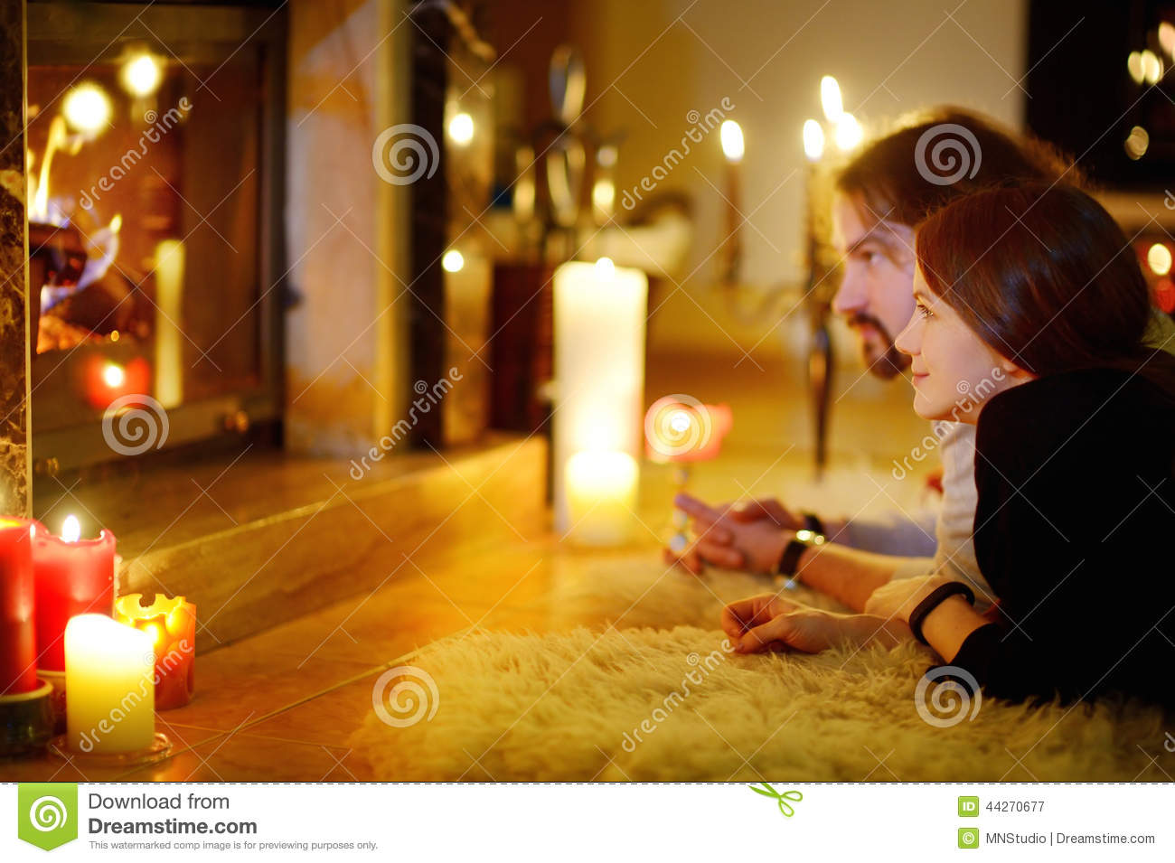 Happy Couple By A Fireplace On Christmas Stock Photo Image 44270677