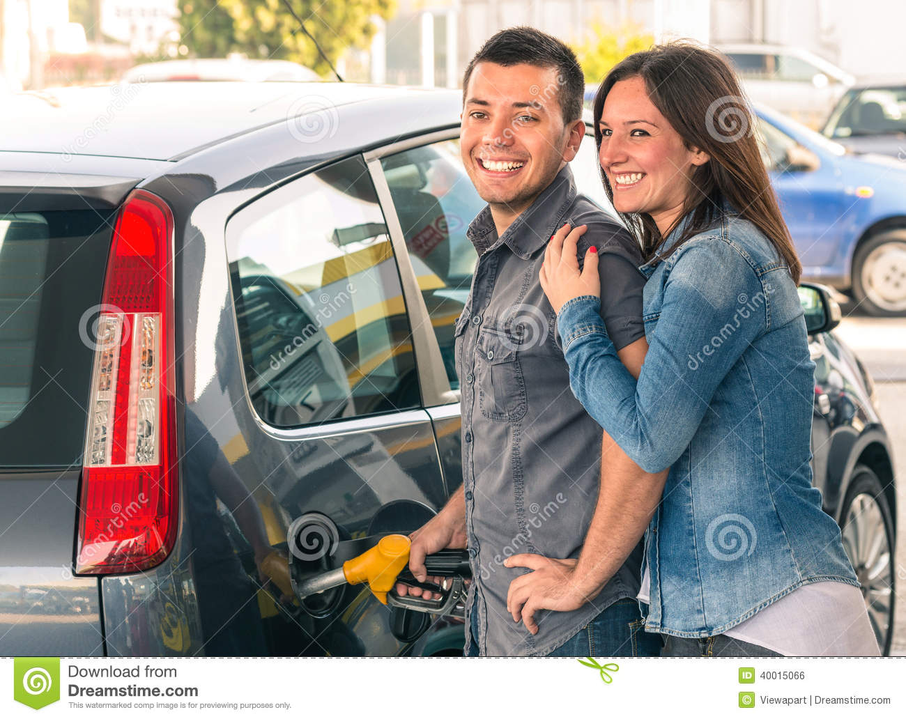 Gas Pump Portrait Of Young Men And Women Filling Modern Car At