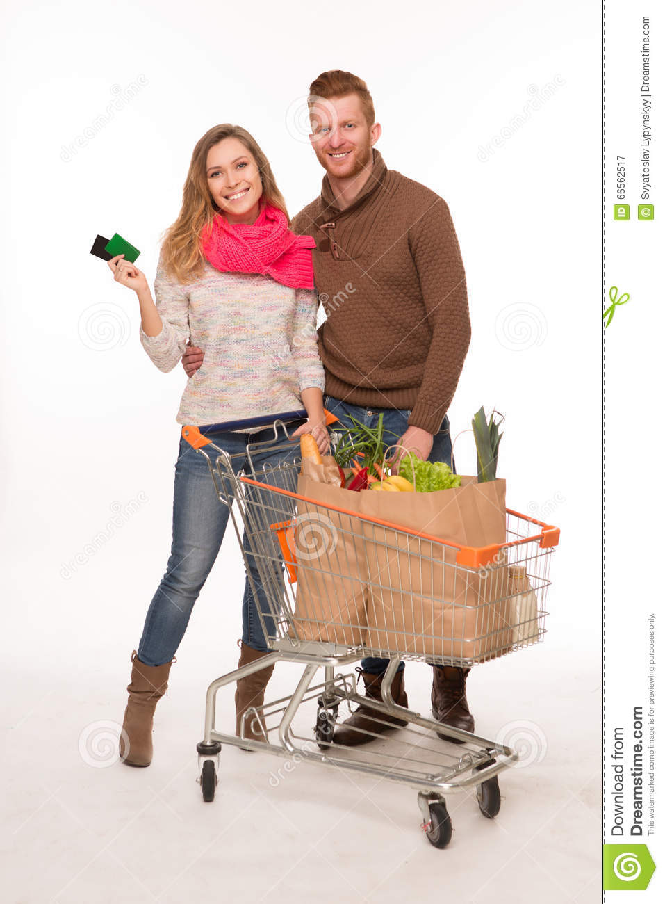 image Couple in supermarket full of people