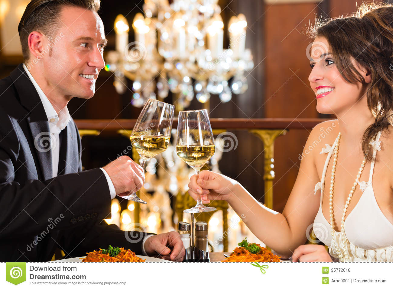 Happy Couple Have A Romantic Date In Restaurant Royalty