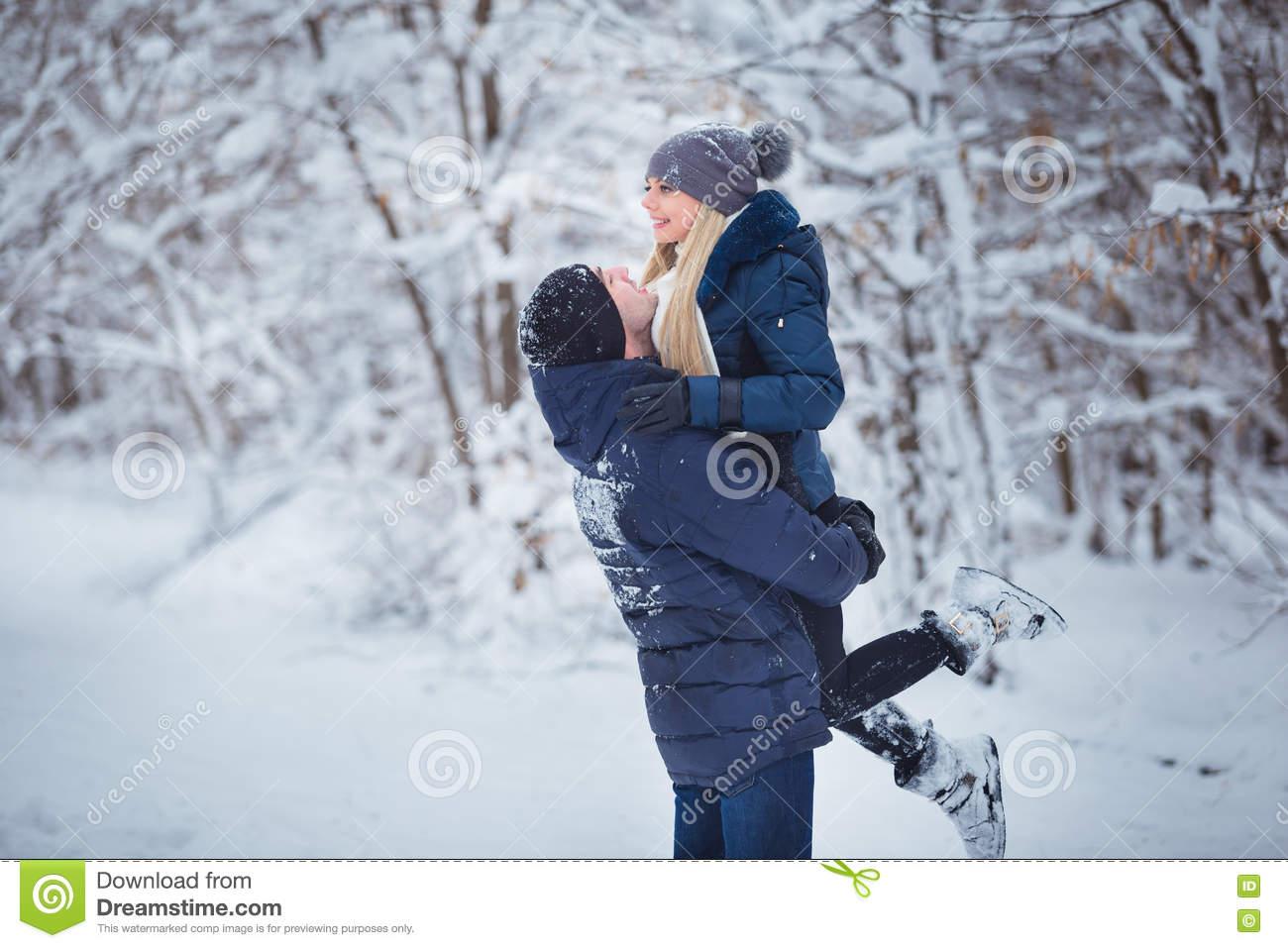 Happy couple having fun outdoors in snow park winter for Vacation in the snow